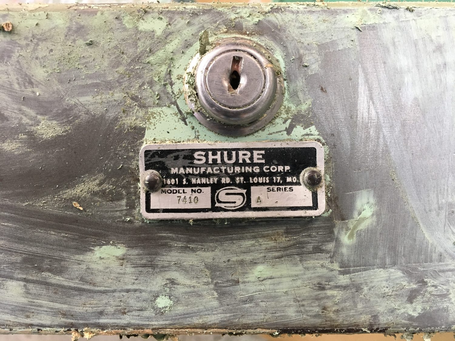 mid century steel tanker desk, displaying the manufacturers tag, Shure Manufacturing Corp.