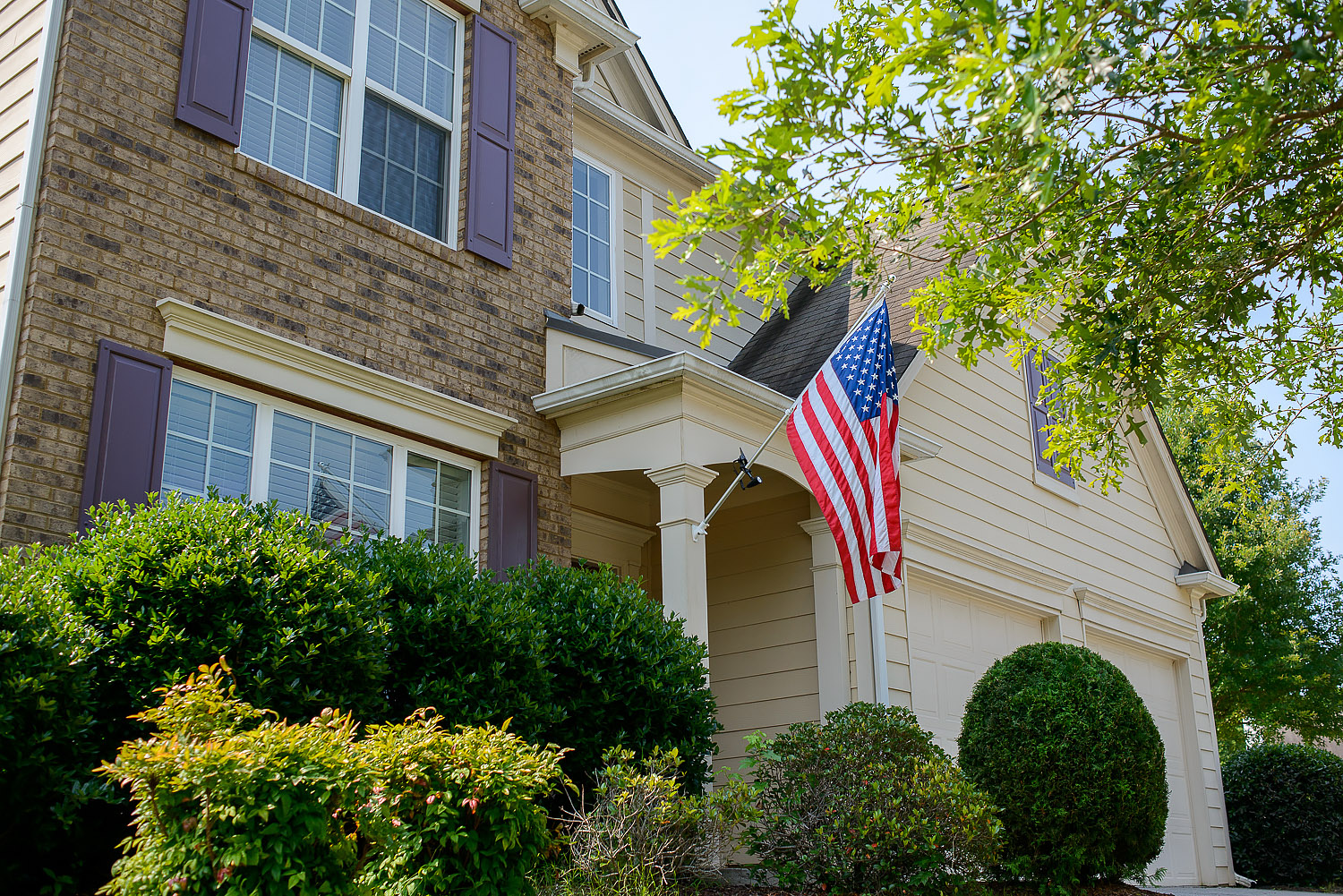 home security podcast, home exterior with American flag