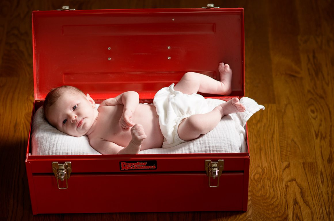 baby in red toolbox
