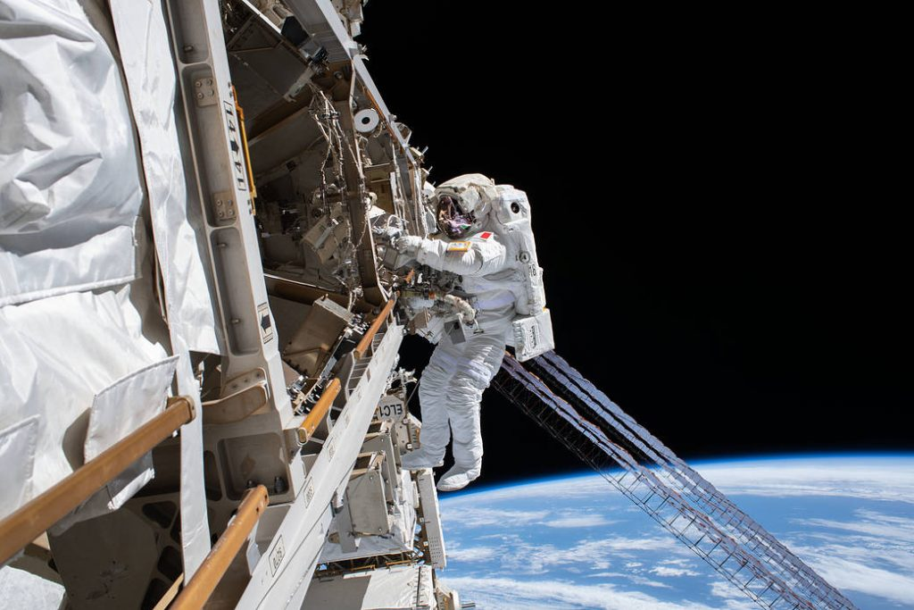 ESA (European Space Agency) astronaut Luca Parmitano is pictured tethered to the International Space Station while finalizing thermal repairs on the Alpha Magnetic Spectrometer, a dark matter and antimatter detector, during a spacewalk that lasted 6 hours and 16 minutes.