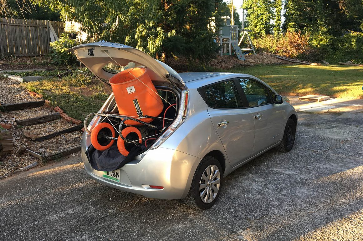 Nissan Leaf with a concrete mixer shoved in the back