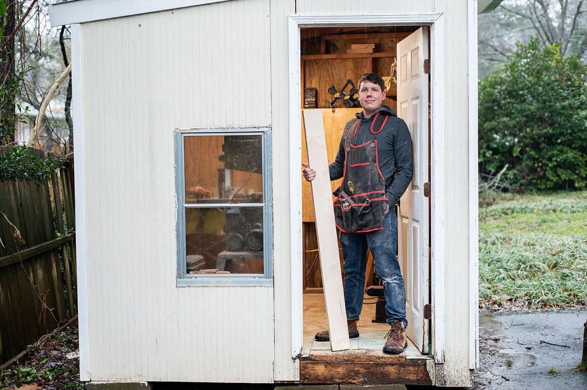 Drew Mapleswright standing in the doorway of his workshop
