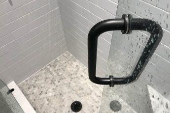 glass shower door with tile detail