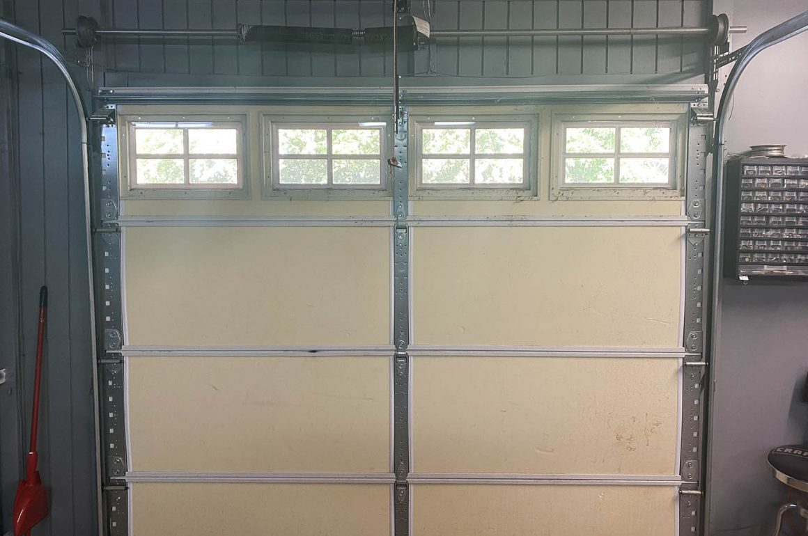 closed garage door with broken torsion spring