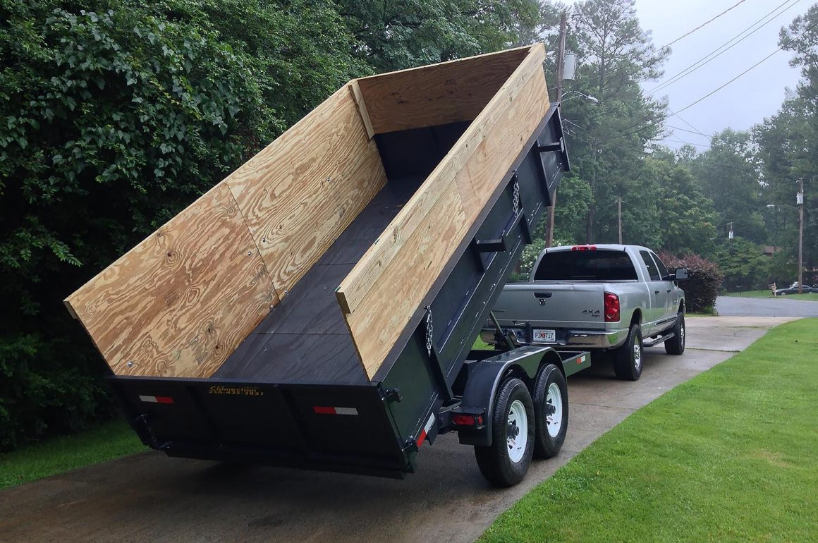 pickup truck with dump trailer attached