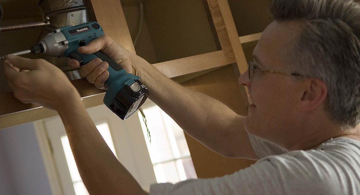 Julian Swann using cordless drill